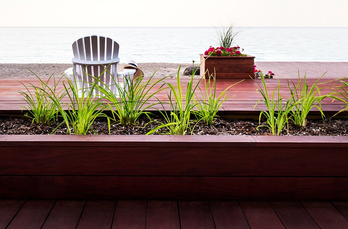 Planters cladded in Mahogany decking boards, fijian Mahogany, fijian mahogany decking, hardwood decking, ipe decking, thermory decking
